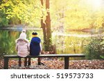 two children on a bench in... | Shutterstock . vector #519573733