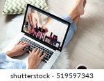 woman watching online tutorial... | Shutterstock . vector #519597343