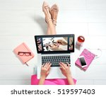 woman watching online tutorial... | Shutterstock . vector #519597403