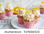 vanilla cupcakes with a cap air ... | Shutterstock . vector #519606523