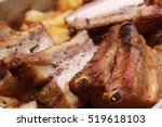 grilled ribs and potatoes | Shutterstock . vector #519618103