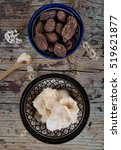 Small photo of Cup of shea butter with shea nuts on wooden table