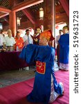 Small photo of Hanoi, Vietnam - July 24, 2016: Men wearing old feudal government official showing respect at commend celebration for family good pupils organised at Temple of Literature (Van Mieu)