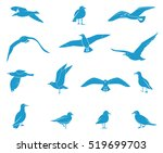 silhouettes of flying seagulls. ... | Shutterstock .eps vector #519699703