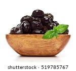 black olives in wooden bowl...   Shutterstock . vector #519785767