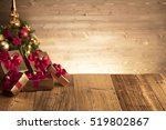 Golden Presents With Red Ribbo...