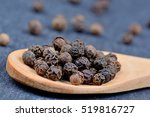 Black Peppercorns In A Wooden...