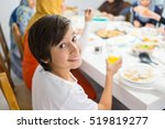 family gathering eating meal... | Shutterstock . vector #519819277
