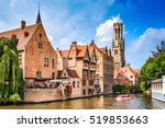 """BRUGES, BELGIUM - 7 August 2014: Scenery with water canal in Bruges, """"Venice of the North"""", cityscape of Flanders, Belgium."""