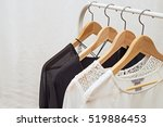 ladies blouses on wooden... | Shutterstock . vector #519886453