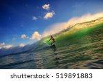 ocean wave surfing girl | Shutterstock . vector #519891883