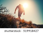 Hiker Crossing Rocky Terrain I...