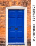 Blue Door With Brick Wall At...