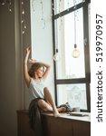 girl sitting on a window in a... | Shutterstock . vector #519970957