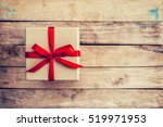 brown gift box with red ribbon... | Shutterstock . vector #519971953
