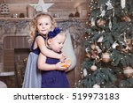 adorable older sister lovingly... | Shutterstock . vector #519973183