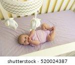 Cute Infant Baby In Purple Cri...