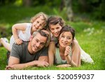 cheerful family in a park  dad  ... | Shutterstock . vector #520059037