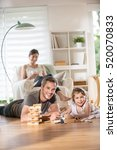cheerful family at home  daddy... | Shutterstock . vector #520070833