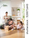 cheerful family at home  daddy... | Shutterstock . vector #520071643