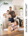 cheerful family at home  a... | Shutterstock . vector #520071667