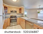 Small photo of Interior of nice u-shaped kitchen room with light wood cabinets , granite counter tops. Northwest, USA