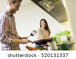 lovely young couple preparing... | Shutterstock . vector #520131337