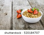 granola with strawberry on a... | Shutterstock . vector #520184707