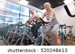 senior couple exercising in gym  | Shutterstock . vector #520248613