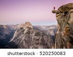 A Male Hiker Standing On An...
