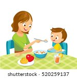 mother feeding baby boy | Shutterstock .eps vector #520259137