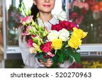 woman holding a bouquet  close  | Shutterstock . vector #520270963