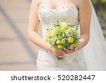 green bouquet in bride's hands | Shutterstock . vector #520282447