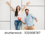 young happy couple standing... | Shutterstock . vector #520308787