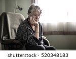 a worried senior woman at home... | Shutterstock . vector #520348183