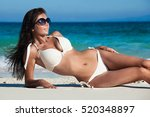 young woman in bikini laying by ... | Shutterstock . vector #520348897