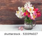 alstromeria flowers in a glass... | Shutterstock . vector #520396027