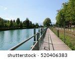a boardwalk along lake thun ... | Shutterstock . vector #520406383