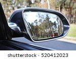 car mirror. forest in rear view ... | Shutterstock . vector #520412023