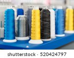 wool and thread spools on desk... | Shutterstock . vector #520424797