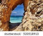 tropical beach  view through a... | Shutterstock . vector #520518913