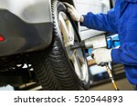 auto mechanic screwing car... | Shutterstock . vector #520544893
