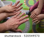 family showing hands together | Shutterstock . vector #520549573