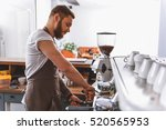 bearded barista tamping ground... | Shutterstock . vector #520565953
