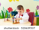 cute boy  kid in wheelchair... | Shutterstock . vector #520639537