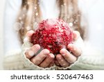 big red christmas ball in hands ... | Shutterstock . vector #520647463