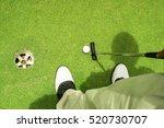 golfer putting golf ball on the ... | Shutterstock . vector #520730707