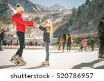 happy family outdoor ice... | Shutterstock . vector #520786957