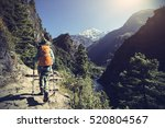 young woman backpacker trekking ... | Shutterstock . vector #520804567