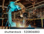 auto robot is welding assembly... | Shutterstock . vector #520806883